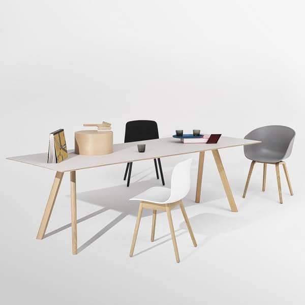 The COPENHAGUE dining table CPH30, made in solid wood and plywood, by ronan and erwan bouroullec