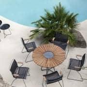 Mesa de comedor redonda CIRCLE, bambú y granito, acero, exterior, by HOUE
